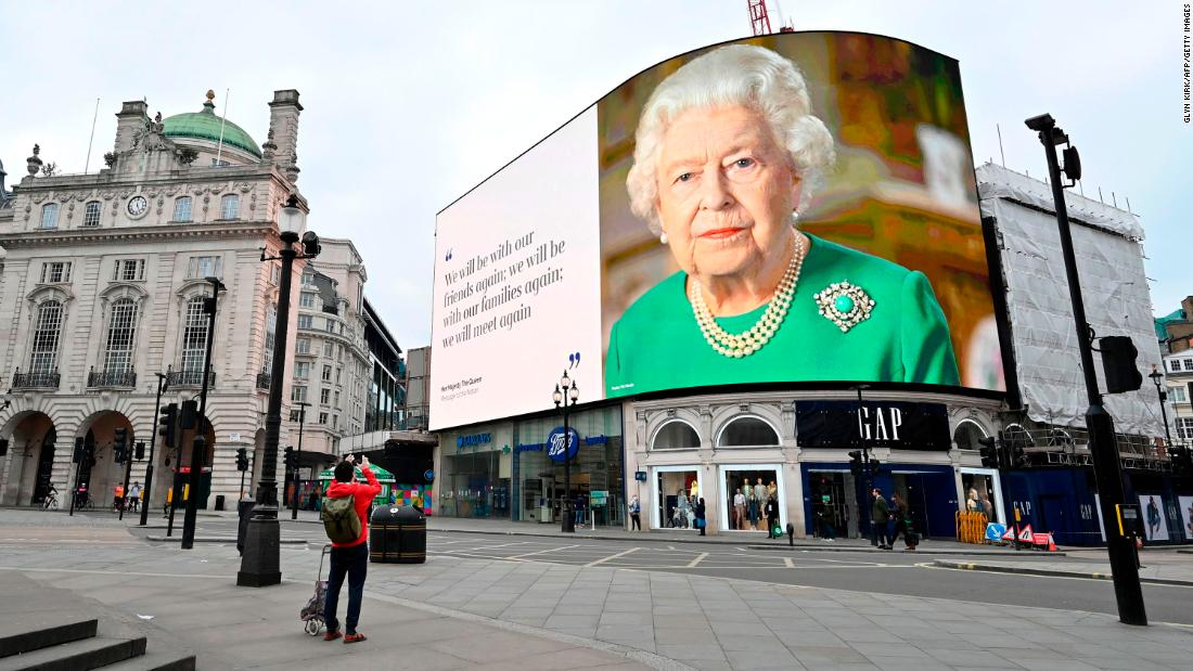"An image of the Queen appears in London's Piccadilly Square, alongside a message of hope from her <a href=""https://edition.cnn.com/2020/04/05/uk/queen-elizabeth-ii-coronavirus-address-gbr-intl/index.html"" target=""_blank"">special address to the nation</a> in April 2020."