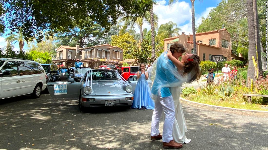 Martin Garret and Dr. Brecken Armstrong, an emergency-room physician, embrace after being married in a small ceremony in Altadena, California, on April 4. The couple were supposed to get married in Greece, but their plans changed because of the pandemic.