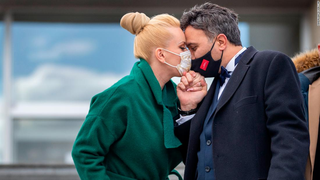 A couple kisses after their wedding ceremony, which included only witnesses, in Vilnius, Lithuania, on April 3.