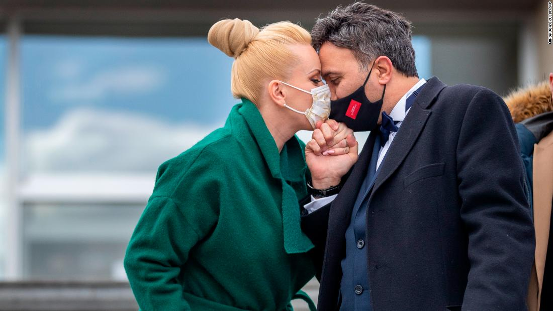 Newlyweds Alla and Modzi kiss through protective face masks after the wedding ceremony with only witnesses, as public gatherings are banned as part of Lithuania's lockdown measures to prevent the spread of coronavirus disease (COVID-19) in Vilnius, Lithuania, Friday, April 3, 2020. All public and private events are banned in Lithuania, clubs, bars restaurants and most shops are closed due to the virus outbreak. The new coronavirus causes mild or moderate symptoms for most people, but for some, especially older adults and people with existing health problems, it can cause more severe illness or death.