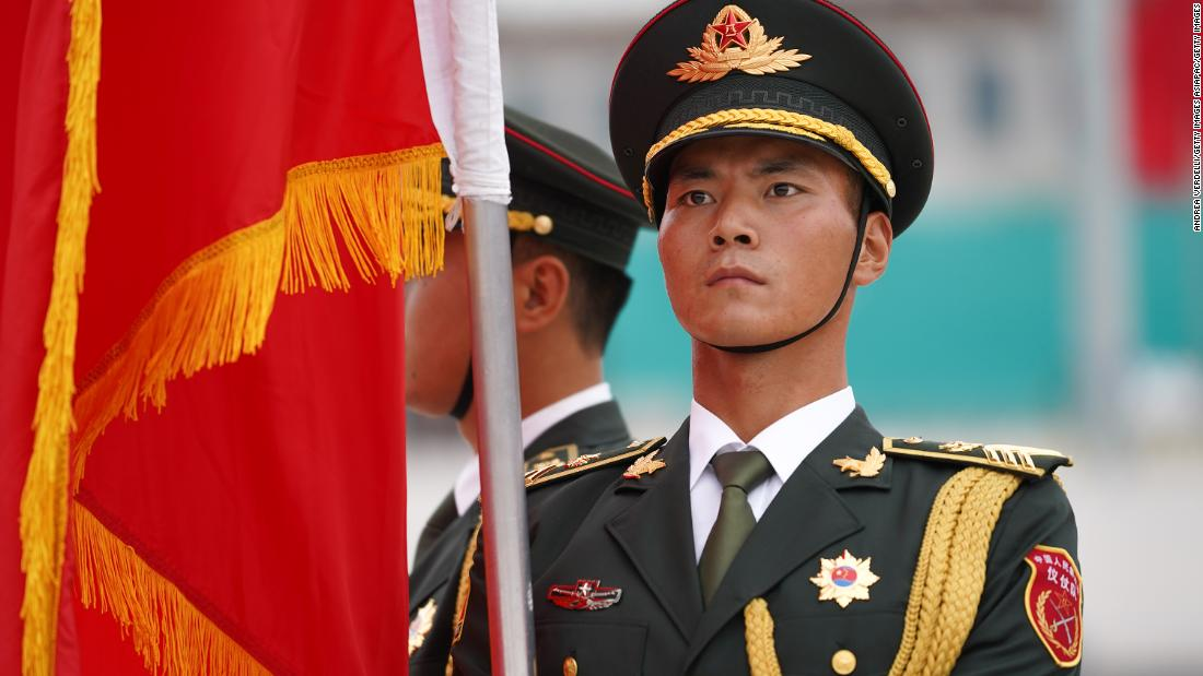 BEIJING, CHINA - SEPTEMBER 11: A soldier holds a flag and stands in preparation for the welcoming ceremony of the meeting between Chinese President Xi Jinping and Kazakh President Kassym Jomart Tokayev (not pictured) on September 11, 2019 at the Great Hall of the People, Beijing, China. (Photo by Andrea Verdelli/Getty Images)
