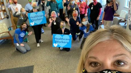 Deb Siggins and some of the health care workers who received her masks.