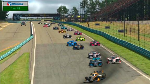 In this image taken from video provided by iRacing IndyCar, Pato O'Ward, foreground, heads into a turn during the opening lap of the American Red Cross Grand Prix virtual IndyCar auto race at Watkins Glen International.