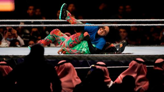 SmackDown Women's Champion Bayley, at top, wrestles with Naomi at WWE Super ShowDown in the second women's match ever to be held in Riyadh, Saudi Arabia.