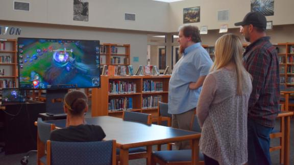 Students, parents and Clinton High School staff gather in the library to watch the March 4 League of Legends match by the Clinton Cougars esports team.