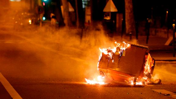 A trash can burns in the street during clashes in Villeneuve-la-Garenne, in the northern suburbs of Paris, early on April 21.
