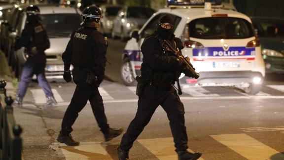 A French police officer with a 40-millimeter rubber defensive bullet launcher LBD (LBD40) walks in a street during clashes in Villeneuve-la-Garenne last Monday.