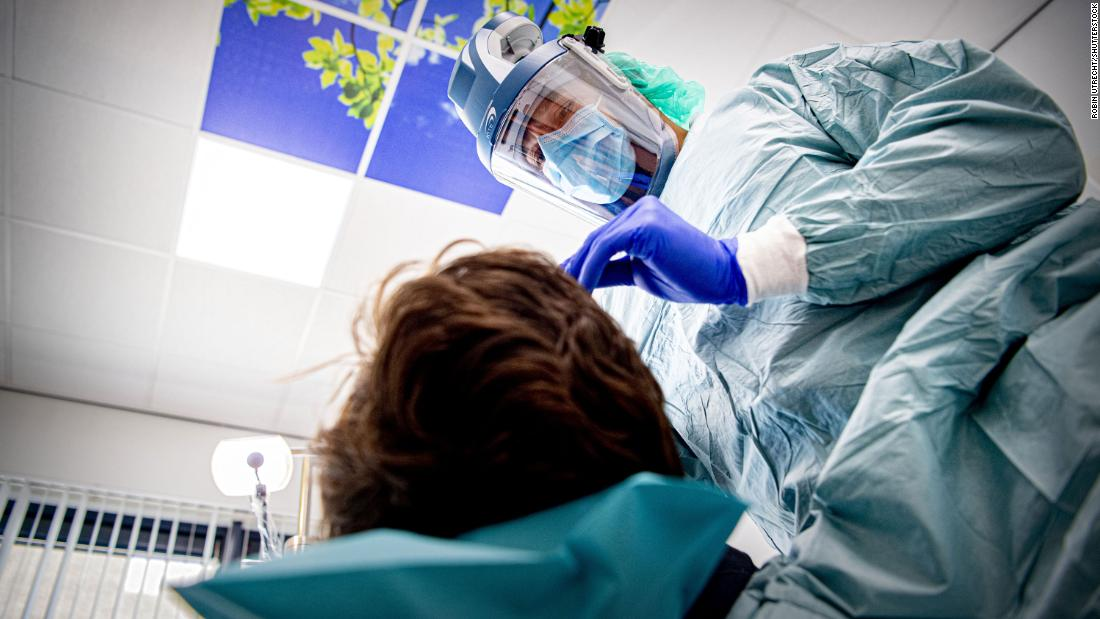 A dentist wears protective equipment while treating a patient in Den Bosch, Netherlands, on April 22.