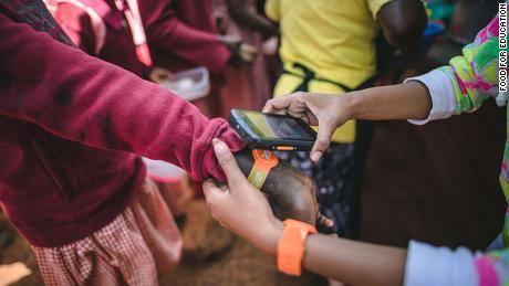 Kids tap their wristband to buy their lunch -- so no more lost lunch money.