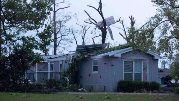 A damaged home is seen after an apparent tornado touched down Wednesday in Onalaska, Texas.