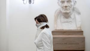 A bust of President Abraham Lincoln is visible behind House Speaker Nancy Pelosi of Calif. as she arrives on Capitol Hill, Thursday, April 23, 2020, in Washington.