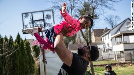 Mo Major exercises in the backyard with his children Marley, 4, and Max, 5, on March 26, 2020, in Mount Vernon, New York. Mo was laid off as a chef consultant and his wife furloughed as a preschool teacher as schools closed due to the coronavirus pandemic.