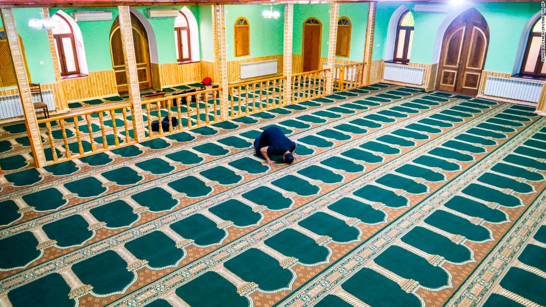 A believer prays in empty mosque at the first day of holy month Ramadan amid the coronavirus outbreak, in Qazax, Azerbaijan on Thursday, April 23, 2020.