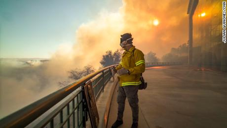 Weir kept the mask he wore as he covered how firefighters worked to save the Reagan Library from the Easy Fire.