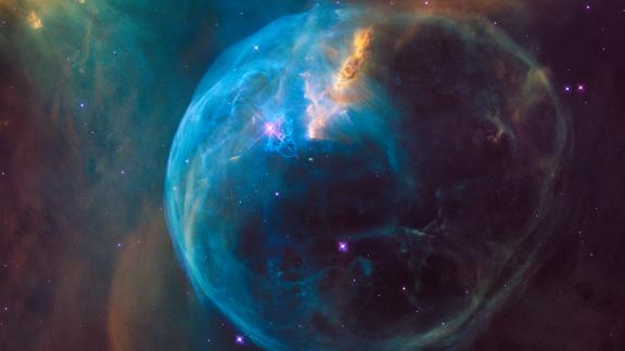 Even stars like to blow bubbles. This 2016 image shares Hubble's view of the Bubble Nebula, where a superhot, massive star is blowing a giant bubble into space. The nebula is 7 light-years across.