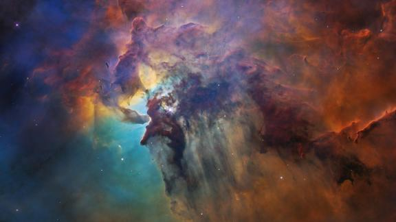 This 2018 Hubble image shows the Lagoon Nebula, a chaotic nursery full of baby stars. At the center of this image, a young star 200,000 times brighter than our sun blasts out ultraviolet radiation.