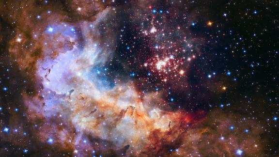 Fireworks are even more beautiful in space. Hubble captured this image of a giant cluster of 3,000 stars in 2015. It's called Westerlund 2, located 20,000 light-years away from Earth.
