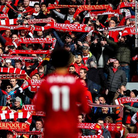 LIVERPOOL, ENGLAND - MARCH 07: Fans of Liverpool hold up scarves during the Premier League match between Liverpool FC and AFC Bournemouth  at Anfield on March 7, 2020 in Liverpool, United Kingdom. (Photo by Robbie Jay Barratt - AMA/Getty Images)