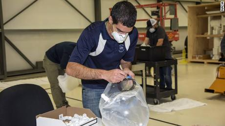 Engineer Mike Buttigieg of NASA works on the Aerospace Valley Positive Pressure Helmet.