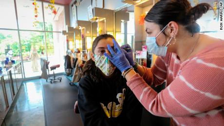 A customer gets her eyebrows waxed at a salon in Marietta, Georgia, on April 24. The salon had been closed for more than a month during the pandemic.