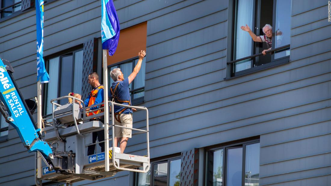 Pitrik van der Lubbe waves from a boom lift to his 88-year-old father, Henk, at his father's nursing home in Gouda, Netherlands. Pitrik had not seen his father in more than four weeks.