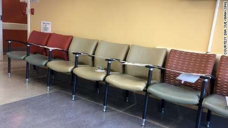 While waiting for an ultrasound to discern whether or not she had kidney stones, Dia Sue-Wah-Sing sat in a waiting room in which unused blocks of chairs created physical distancing between patients.