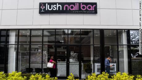 People wait outside a nail salon in Atlanta, Georgia, on Friday.