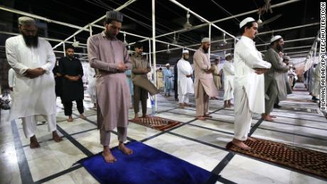 Muslims offer special taraveeh prayers during the Muslim holy month of Ramadan in Peshawar, Pakistan, on April 24, 2020.