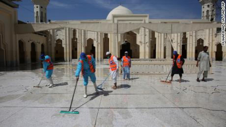 Volunteers disinfect a mosque ahead of the Muslim fasting month of Ramadan, in Peshawar, Pakistan, on April 24, 2020.