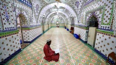 A Muslim devotee recites the Quran at the Star Mosque during Ramadan in Dhaka, Bangladesh, April 26, 2020.