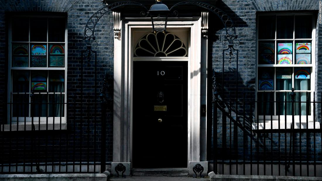 A view of 10 Downing Street with messages in support of the NHS and key workers in the windows, in London, Sunday, April 26, 2020. British Prime Minister Boris Johnson is returning to work after recovering from a coronavirus infection that put him in intensive care. Johnson's office says he will be back at his desk Monday, two weeks after he was released from a London hospital. (AP Photo/Alberto Pezzali)