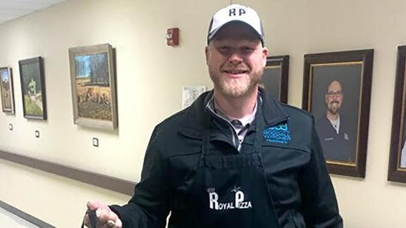 Adam Willmann, president and CEO of Goodall-Witcher Healthcare, delivers pizza to employees.