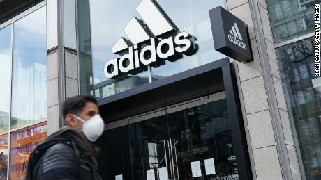 BERLIN, GERMANY - APRIL 15: A man wearing a protective face mask, who said he did not mind being photographed, walks past a temporarily closed Adidas store during the coronavirus crisis on April 15, 2020 in Berlin, Germany. As the rate of new infections nationwide continues to slow, the German government is seeking to establish and implement a roadmap for easing restrictions on public life and the burden the virus is having on the economy. So far over there are over 130,000 cases of confirmed infection of coronavirus in Germany, over 3,000 people have died and over 57,000 people have recovered. (Photo by Sean Gallup/Getty Images)