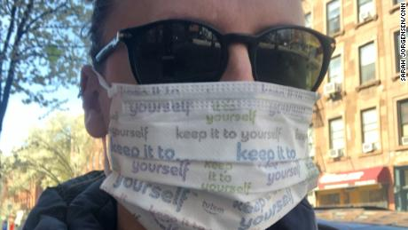 Sarah Jorgensen wears a mask as she heads out on one of her pharmacy visits.