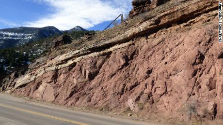 This rock exposes the Great Unconformity, where 1.1 billion-year-old Pikes Peak granite is topped with 510 million-year-old sandstone outside of Manitou Springs, Colorado.