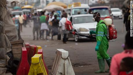 A city worker disinfects a market in Accra, Ghana as a preventive measure against the spread of Covid-19.