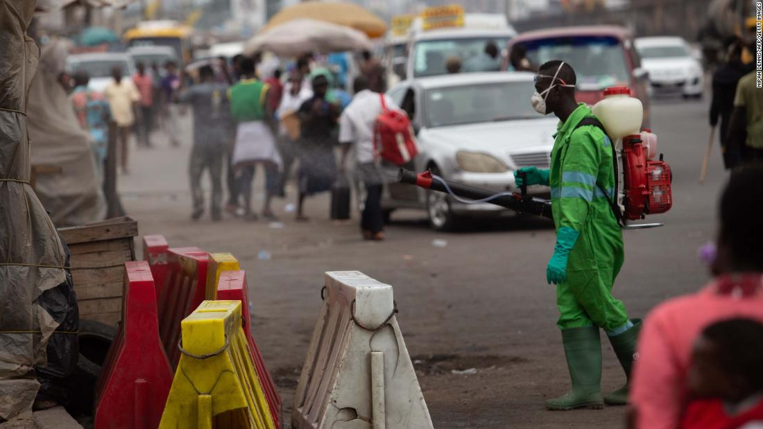 A city worker disinfects a market as a preventive measure against the spreading of COVID-19 Coronavirus in Accra on March 23, 2020. - African countries have been among the last to be hit by the global COVID-19 coronavirus epidemic but as cases rise, many nations are now taking strict measures to block the deadly illness. (Photo by Nipah Dennis / AFP) (Photo by NIPAH DENNIS/AFP via Getty Images)