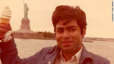 Gireesh Kumar Suri died at age 67 last week. He is pictured here with the Statue of Liberty,  not long after he arrived in America.