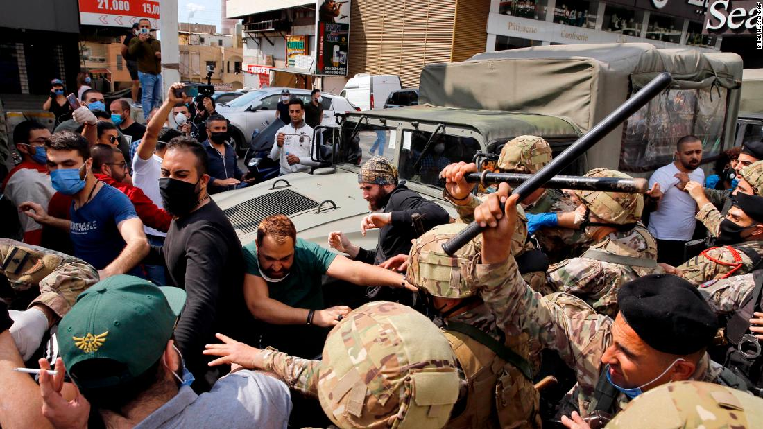Anti-government protesters scuffle with Lebanese army soldiers in the town of Zouk Mosbeh, north of Beirut, Lebanon, Monday, April 27, 2020. Bilal Hussein/AP