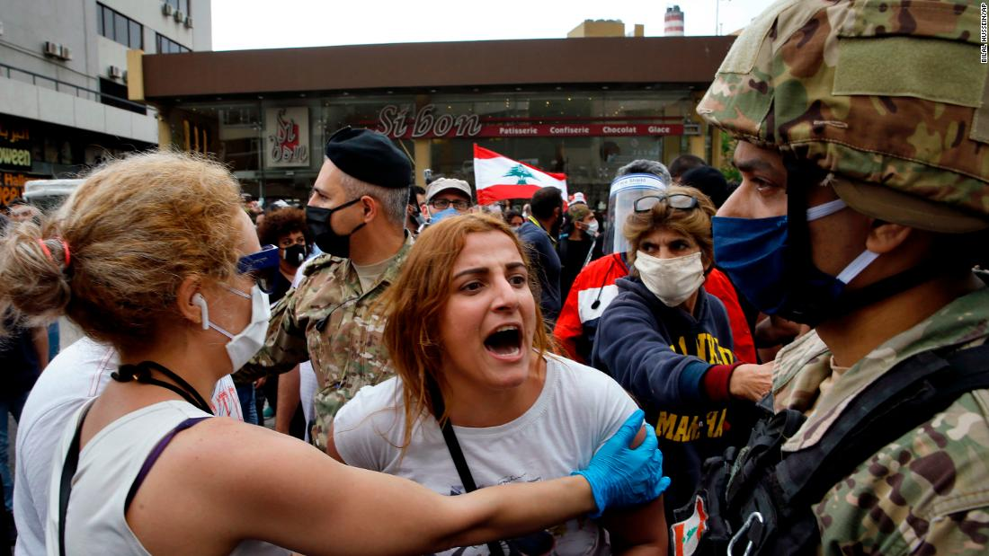 An anti-government protester scuffles with Lebanese army soldiers in the town of Zouk Mosbeh, north of Beirut, Lebanon, Monday, April 27, 2020. Bilal Hussein/AP