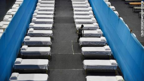 A worker arranges beds for a quarantine centre in Guwahati on March 29, 2020.