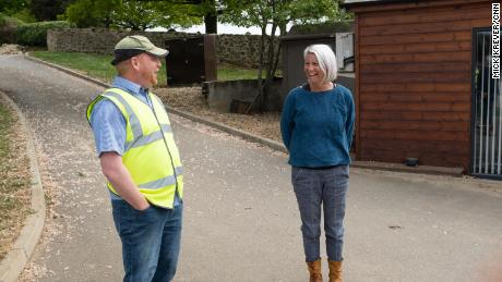 """Nick Ottewell talks with Sally Penfold, 45, who says providing the nation with food is """"an honorable thing to do."""""""