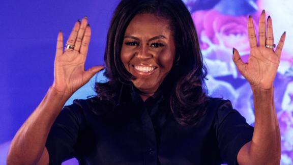 Former U.S. First Lady Michelle Obama arrives on stage at an event at the Elizabeth Garrett Anderson School on December 03, 2018 in London, England.