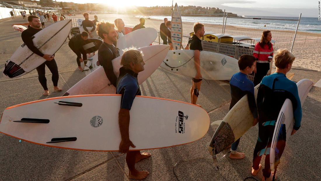 Surfers wait for officials to open Bondi Beach in Sydney, on Tuesday, April 28, as coronavirus pandemic restrictions are eased. The beach is open to swimmers and surfers to exercise only. Rick Rycroft/AP