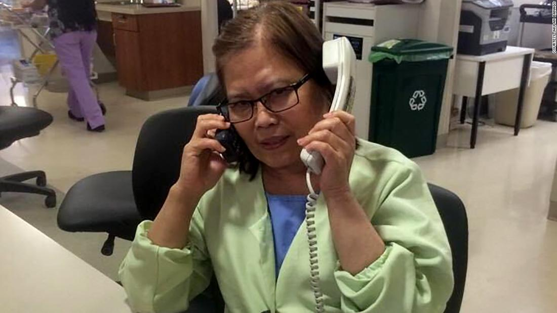 """Jhulan Banago says this photo of his mom, Celia Yap-Banago, always makes him laugh. """"I think it encompasses mom -- hardworking and joking. No one answers two phones and has two conversations at once. ... It's nice to see that mom was so happy at work."""""""