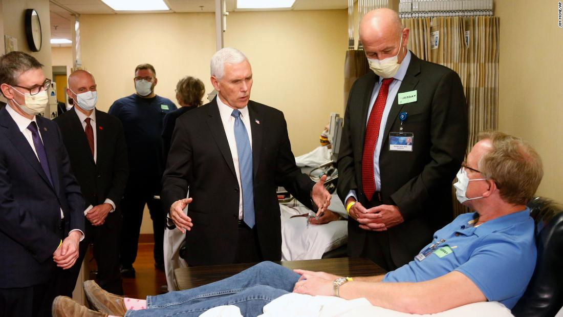 "US Vice President Mike Pence visits Dennis Nelson, a patient who survived the coronavirus and was going to give blood, during a tour of the Mayo Clinic in Rochester, Minnesota, on April 28, 2020. <a href=""https://www.cnn.com/2020/04/28/politics/mike-pence-mayo-clinic-mask/index.html"" target=""_blank"">Pence chose not to wear a face mask during the tour</a> despite the facility's policy that's been in place since April 13. Pence told reporters that he wasn't wearing a mask because he's often tested for coronavirus."