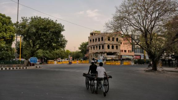 A man pushes a hand cart on a closed street during lockdown in New Delhi, India on 28 April 2020.