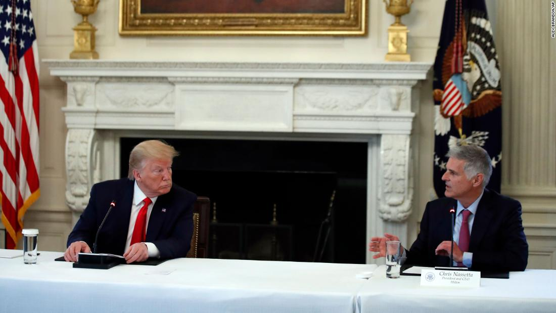 Fact check: Hilton CEO shatters Trump's testing conspiracy theory while sitting beside him
