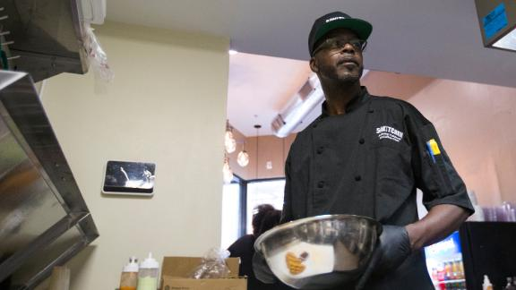 Anthony Caldwell, owner and executive chef at 50Kitchen in Boston's Dorchester, plates a chicken and waffle dish on Feb. 21, 2020. Caldwell claims that cooking and God saved him, and turned his life around from a troubled past. 50Kitchen, at 1450 Dorchester Ave., has its grand opening on Sunday. (Photo by Blake Nissen for The Boston Globe via Getty Images)