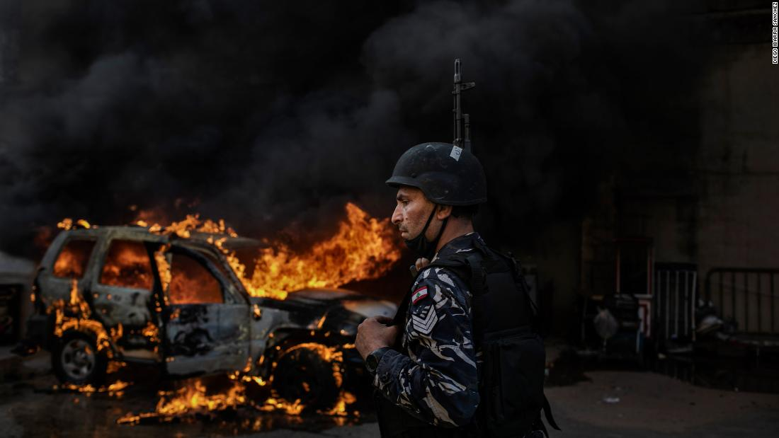 A police car burns in Tripoli on Tuesday.